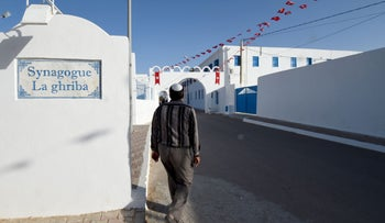 A Tunisian Jew walks in front of the Ghriba Synagogue, thought to be Africa's oldest synagogue, one day before the Jewish annual pilgrimage in Djerba on May 24, 2016.
