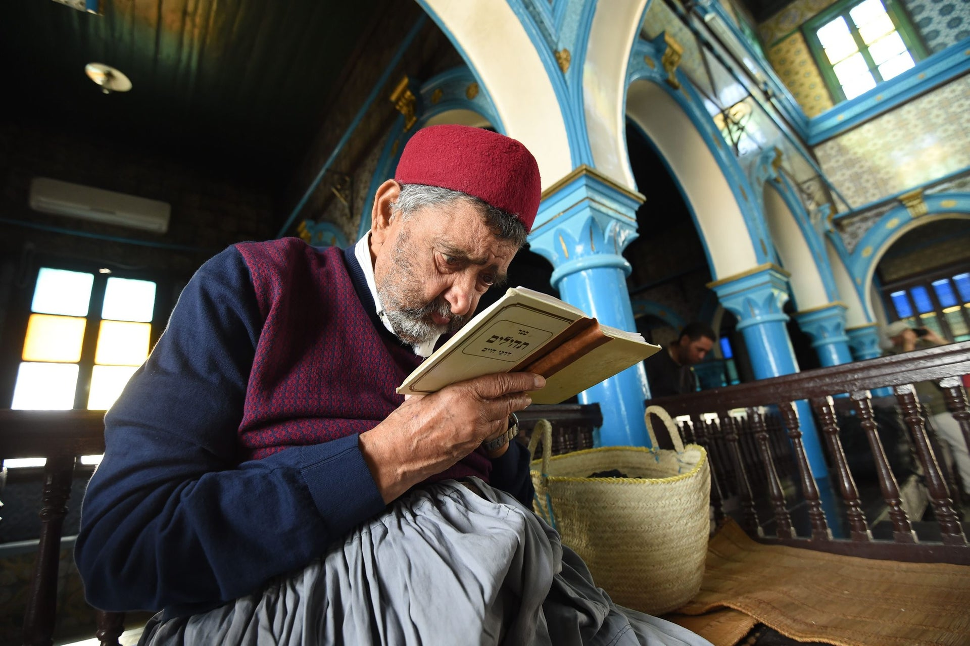 Tunisian Rabbi Attoughi reads the Torah, Judaism's most important text, at the Ghriba synagogue in the Tunisian resort island of Djerba during the annual Jewish pilgrimage on May 25, 2016.