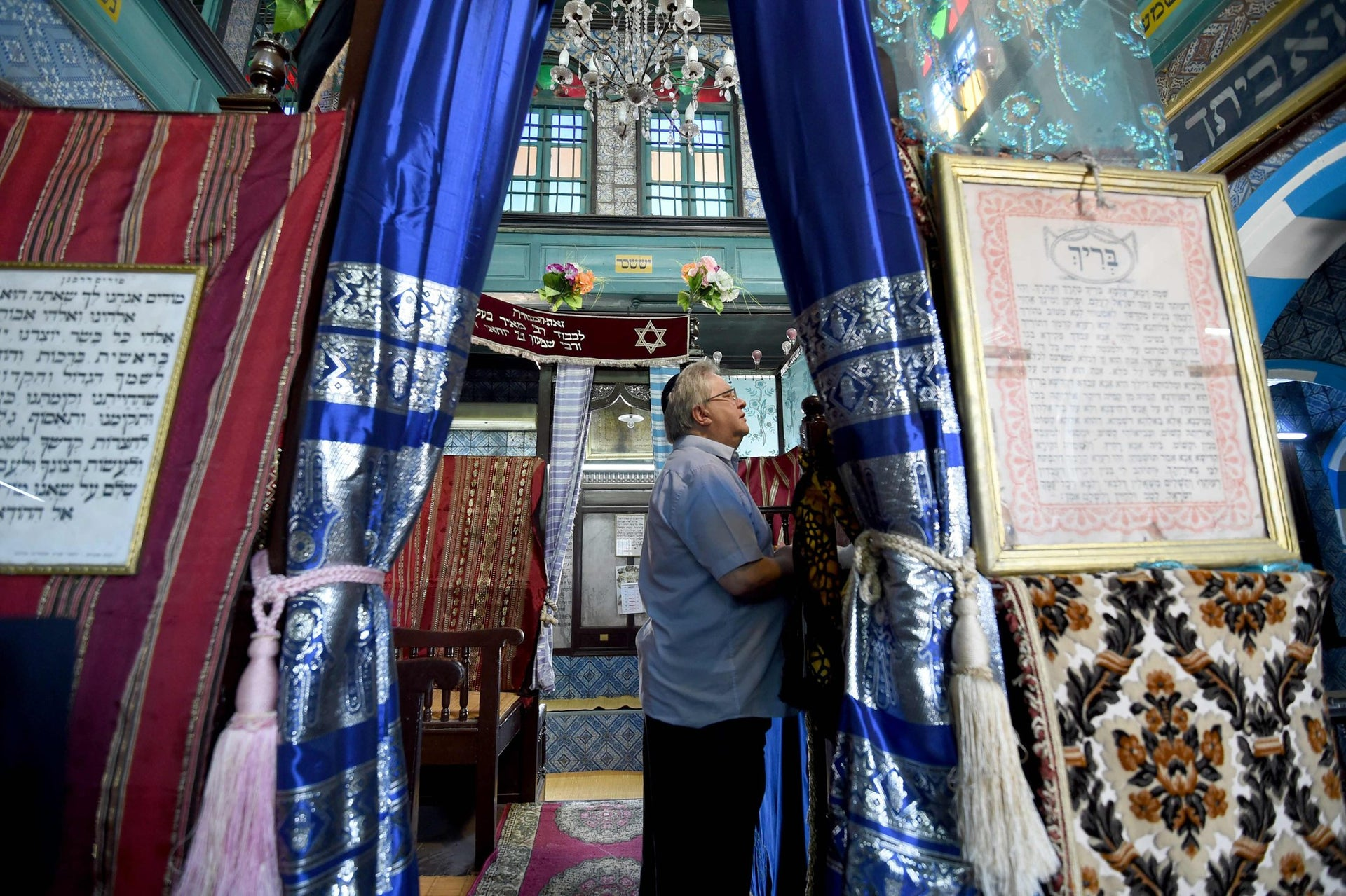 Chief executive of Liberal Judaism in the United Kingdon Rabbi Danny Rich prays at the Ghriba synagogue in the Tunisian resort island of Djerba during the annual Jewish pilgrimage on May 25, 2016.