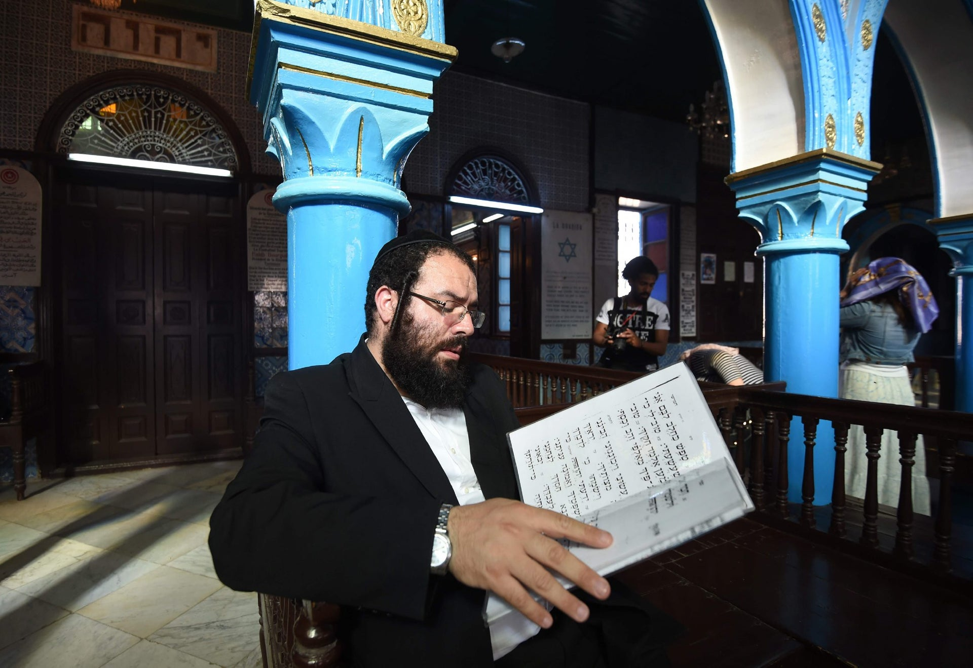 An Israeli rabbi reads the Torah, Judaism's most important text, at the Ghriba synagogue on the Tunisian resort island of Djerba during the annual Jewish pilgrimage on May 25, 2016.