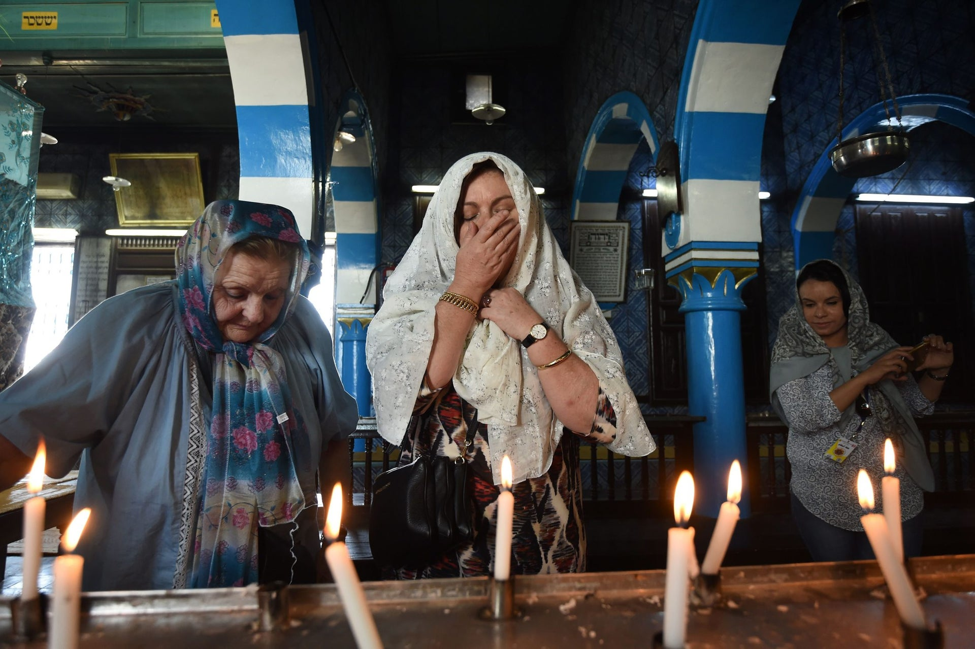 French Tunisian Jewish women pray at the Ghriba synagogue in the Tunisian resort island of Djerba during the annual Jewish pilgrimage on May 25, 2016.