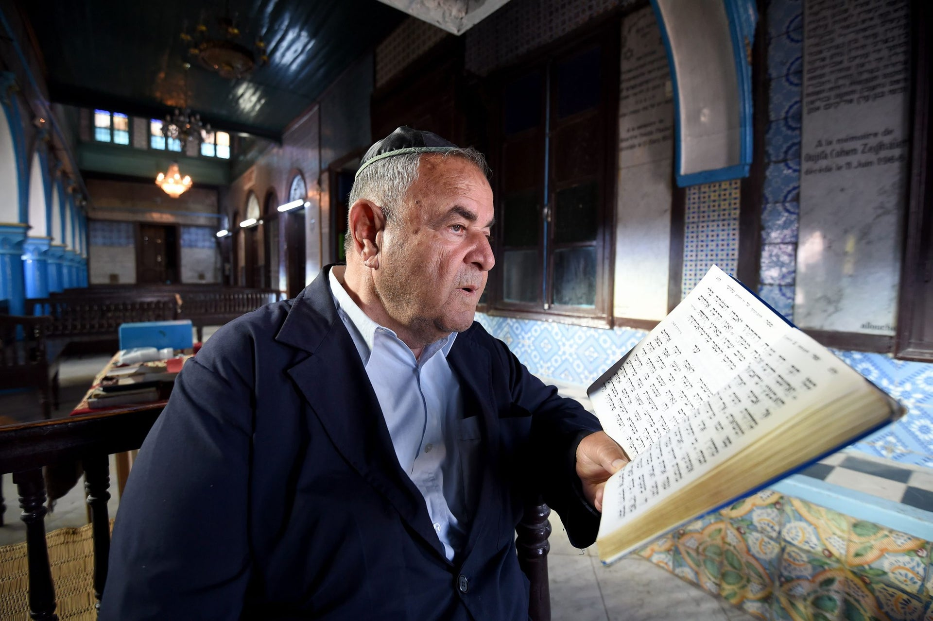Tunisian Jewish Perez Trabelsi, President of the Jewish community of Djerba reads the Torah, Judaism's most important text, at the Ghriba synagogue on the Tunisian resort island of Djerba one day before the start of a two-day annual pilgrimage, on May 24, 2016.