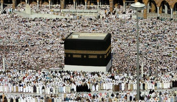 Tens of thousands of Muslim pilgrims attend Hajj prayers at the holy Kaaba in 2006.