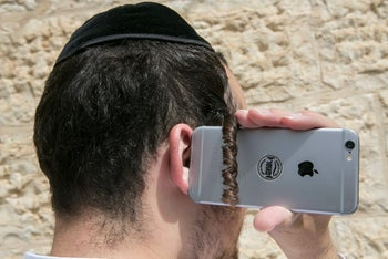 An ultra-Orthodox man with a smartphone.