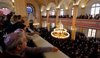 Turkish Jewish community members attend the re-opening ceremony of the Great Synagogue of Edirne in western Turkey, March 26, 2015.