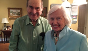 Dr. Henry Heimlich (L), 96, the surgeon credited with inventing the Heimlich Maneuver, poses with Patty Ris, 87, who he saved this week from choking on a hamburger, at the Deupree House seniors' home in Cincinnati, Ohio.