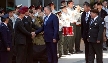 Defense Minister Avigdor Lieberman (center) shakes hands with the IDF's top generals at military headquarters in Tel Aviv on Tuesday, May 31, 2016.