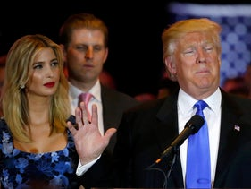 Republican U.S. presidential candidate Donald Trump speaks as his daughter Ivanka looks on during a campaign victory party in Manhattan, New York, U.S., May 3, 2016.