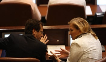 Zionist Union leaders Isaac Herzog and Tzipi Livni at the Knesset last year.