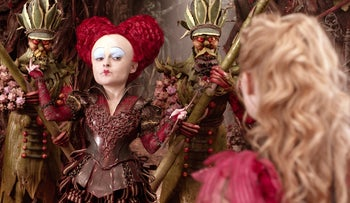 "In this image released by Disney, Helena Bonham Carter, left, and Mia Wasikowska appear in a scene from ""Alice Through The Looking Glass."""