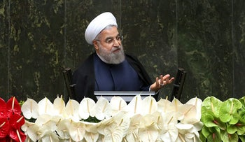 Iranian President Hassan Rohani speaks in parliament on May 2016.