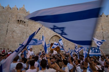 Waving flags during a march marking Jerusalem Day near Damascus Gate outside Jerusalem's Old City May 17, 2015.