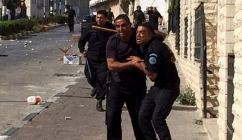 Palestinian Authority police trying to stop Palestinian protesters from approaching Israeli army checkpoint in Bethlehem, September 18, 2015.