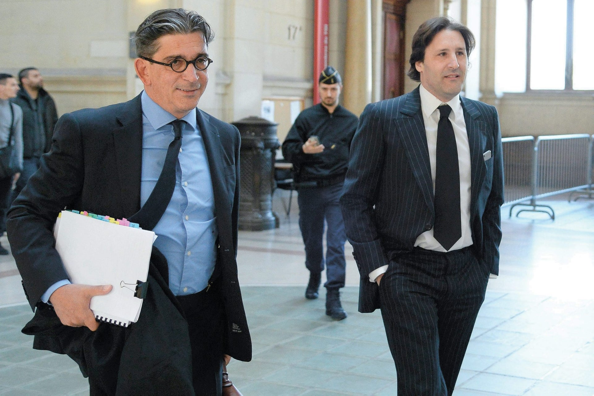 Arnaud Mimran, right, and his lawyer at the Paris courthouse, on May 25, 2016, to attend his trial.