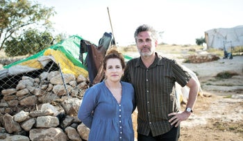 American authors Ayelet Waldman and Michael Chabon visiting Susya in the West Bank.