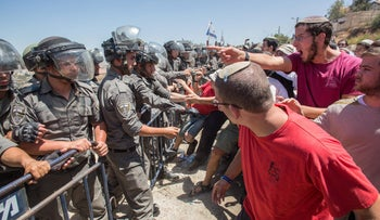 Settlers clash with security forces in Beit El, July 27, 2015.