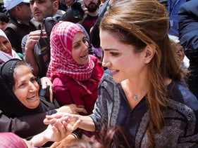 Queen Rania of Jordan is greeted by refugees and migrants during her visit to Kara Tepe municipality camp in the Greek island of Lesbos, Greece, April 25, 2016.