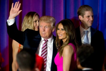 Republican presidential candidate Donald Trump waves at supporters as he leaves the stage with his wife Melania after a news conference in New York on Tuesday, June 7, 2016.