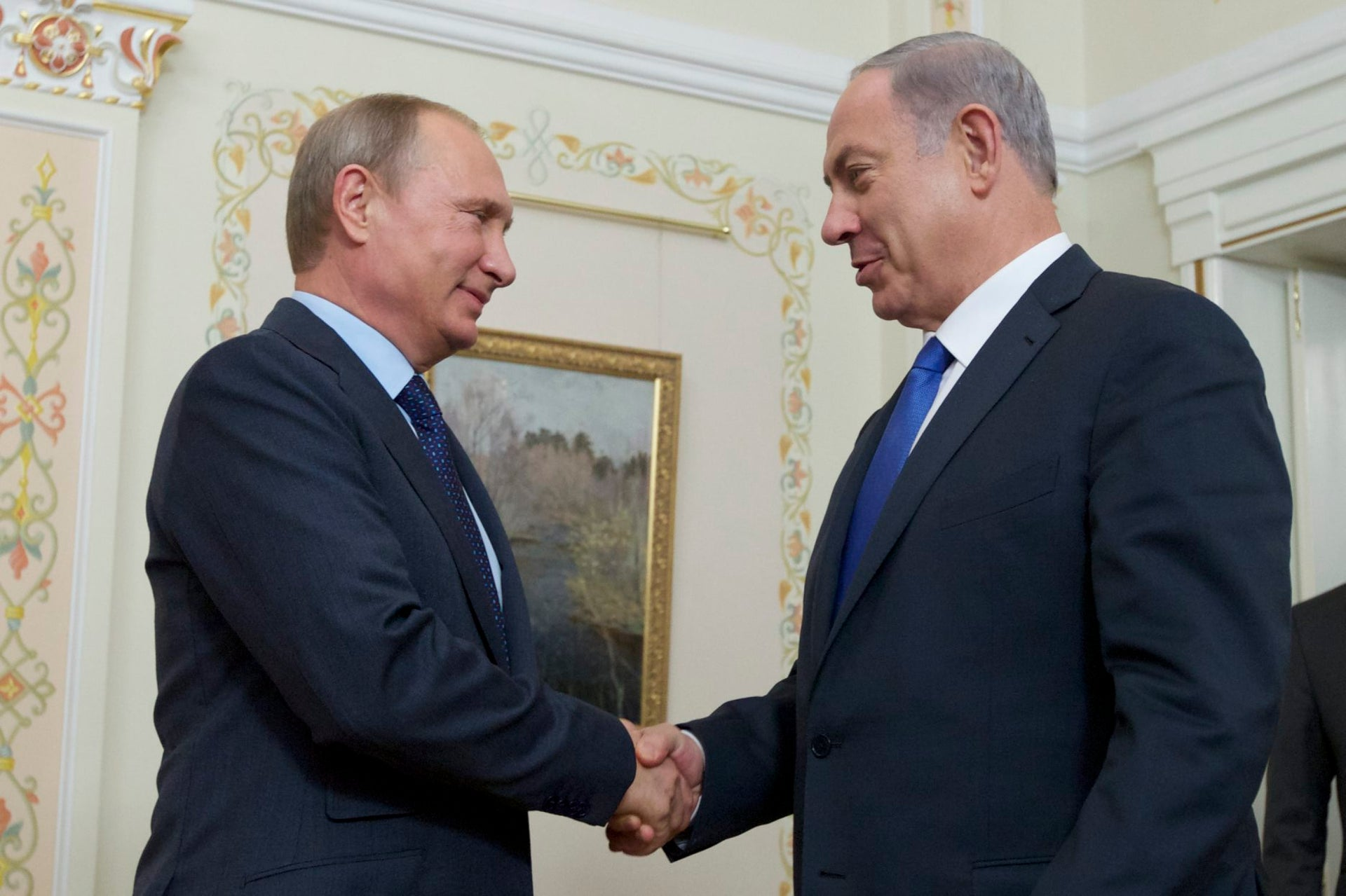Russian President Vladimir Putin shakes hands with Israeli Prime Minister Benjamin Netanyahu, right, during their Sept. 21 meeting in Moscow.