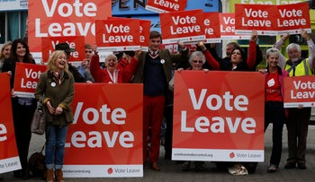 Supporters of the Vote Leave campaign cheer as they wait for Boris Johnson during the first day of a nationwide bus tour to campaign for a Brexit, Truro, U.K., May 11, 2016.