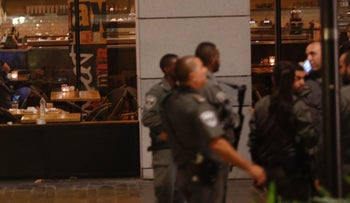 Policemen operate at the site of a terror attack at Sarona Market in Tel Aviv on Wednesday, June 8, 2016.
