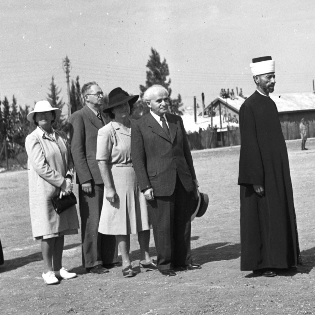 Arab and Jewish leaders standing in line at an official reception.