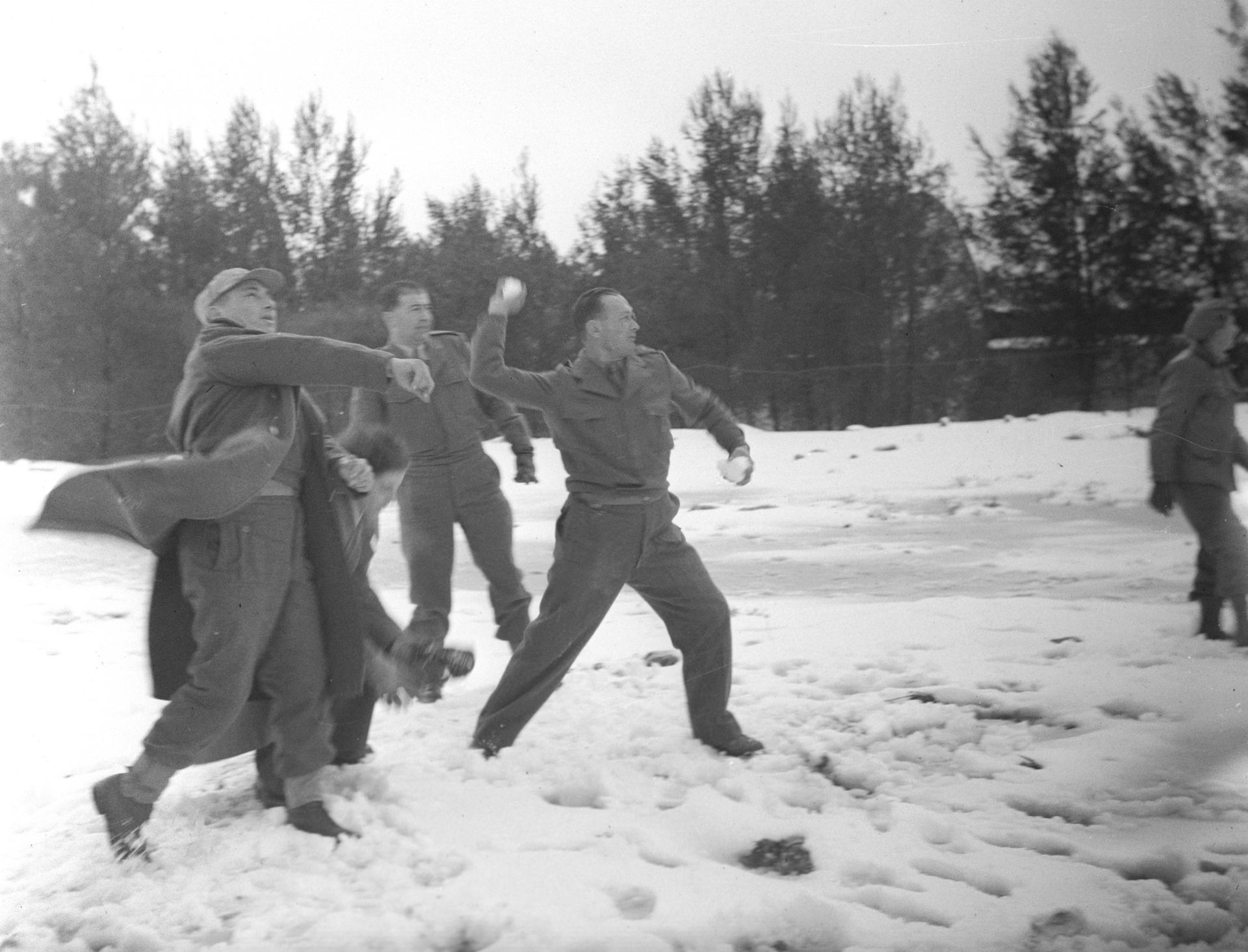 Moshe Dayan playfully throwing a snowball.