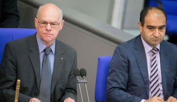 Norbert Lammert sits next to MP of green party Bündnis Die Grünen Özcan Mutlu during a plenary session concluding the so-called Armenian Genocide Resolution in Berlin, June 9, 2016.