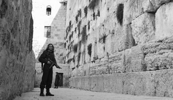 An Arab, armed with a sub-machine gun, stands guard at Jerusalem's Wailing Wall on Feb. 23, 1948.