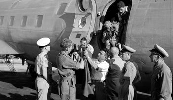 Jewish Agency representatives greet Yemenite immigrants upon arrival in Israel.