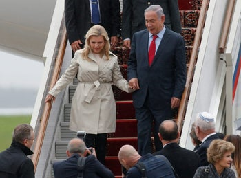 Prime Minister Benjamin Netanyahu disembarks with his wife Sara from a plane upon his arrival at Moscow's Vnukovo airport, Russia, June 6, 2016.