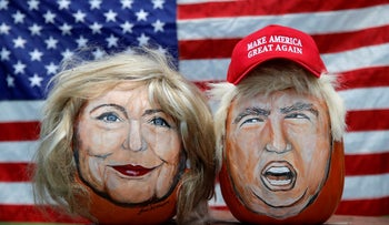 The images of U.S. Democratic presidential candidate Hillary Clinton (L) and Republican Presidential candidate Donald Trump are seen painted on decorative pumpkins created by artist John Kettman in LaSalle, Illinois, U.S., June 8, 2016.