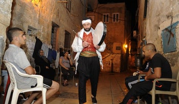 Ayoub walks through the alleys of Acre's Old City.