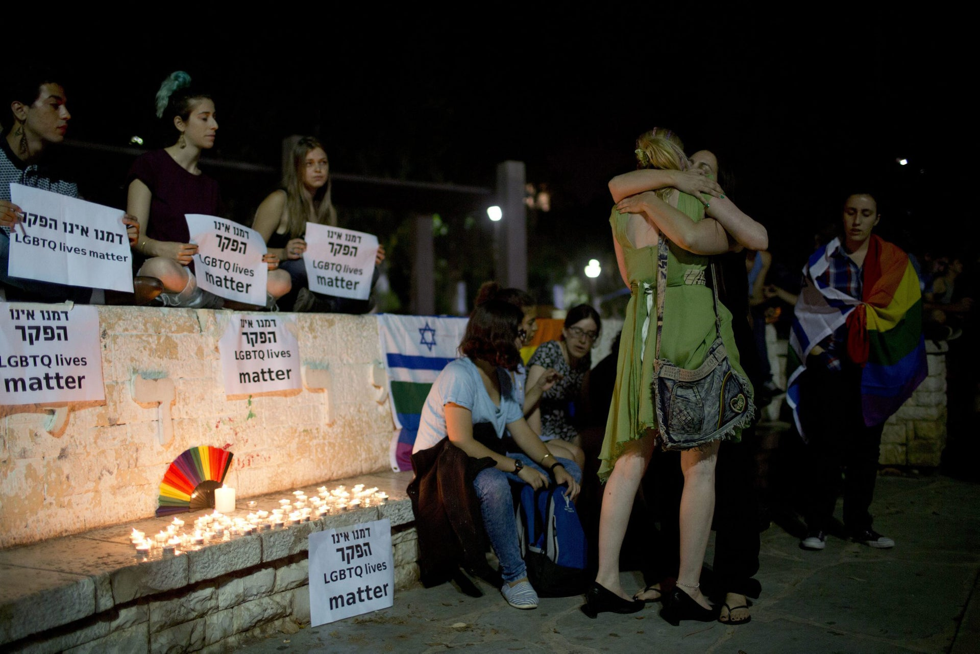 Members LGBT community light candles in solidarity with Florida's shooting attack victims in Tel Aviv, Israel, Sunday, June 12, 2016. The shooting attack in Orlando, Florida, USA, Sunday, left more than 50 people dead amid a multitude of events celebrating LGBT Pride Month.