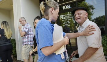 A Oneblood staff member thanks a man for waiting in line to donate blood on June 13, 2016 in Orlando, Florida.