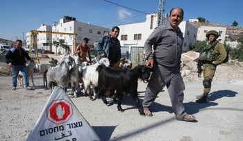 An IDF checkpoint in Yatta, set up after the June 8 terror attack in Tel Aviv by two of the West Bank town's residents, June 10, 2016.