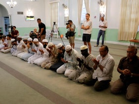 Worshipper at the Islamic Center of Fort Pierce pray for the victims of the Orlando shooting in Fort Pierce, Florida, June 12, 2016.