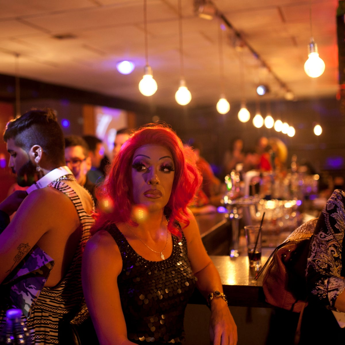 Partygoers at Tel Aviv's Evita club have a moment of silence in honor of the victims of the mass shooting at a gay club in Orlando, June 14, 2016.