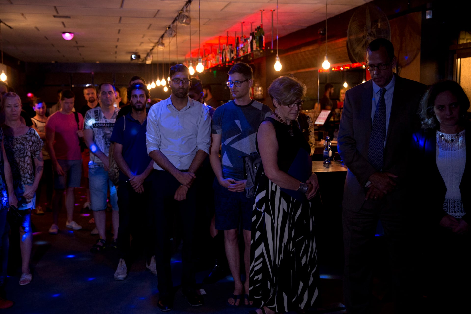 Partygoers at the Evita club have a moment of silence in honor of the victims of the mass shooting at a gay club in Orlando, Tel Aviv, Israel, June 14, 2016.