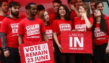Supporters for the U.K. opposition Labour Party hold up banners at a launch event for the 'Labour In Britain' campaign bus in London, U.K., May 10, 2016.
