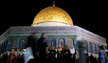 Muslim women pray in front of the Dome of the Rock on the Temple Mount in Jerusalem's Old City during the holy month of Ramadan, June 7, 2016.