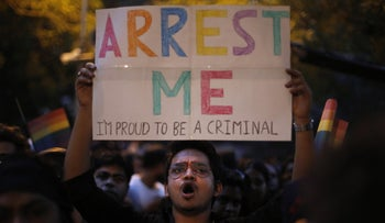 An Indian gay rights activist in New Delhi holds up a placard during a protest after the country's top court ruled that a colonial-era law criminalizing homosexuality will remain in effect in India, Dec. 11, 2013.