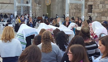 Women of the Wall recite the priestly blessing at the Western Wall in May, 2016.