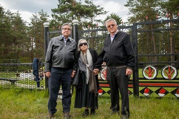Ze'eva Zavidov with Ya'akov and Yossi Ahimeir outside the Kamenka memorial to 10,000 Jews of Babryusk.