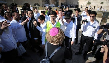 Ultra-Orthodox protesters seek to disrupt egalitarian prayers held by Reform and Conservative worshipers at the Western Wall on June 16, 2016.