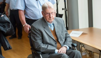 Reinhold Hanning, a former SS guard at Auschwitz, arrives at a courtroom in Detmold, Germany, June 11, 2016.