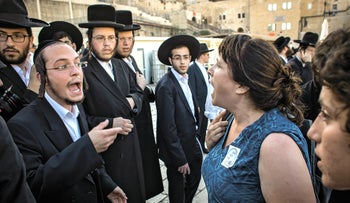 Ultra-Orthodox protesters argue with Reform and Conservative worshipers at the Western Wall on June 16, 2016.