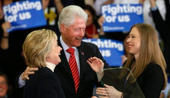 Democratic U.S. presidential candidate Hillary Clinton is accompanied by her daughter Chelsea Clinton and her husband, former U.S. President Bill Clinton, as she speaks to supporters on February 9, 2016.