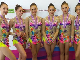 Israeli team poses for a picture after being awarded the gold medal for rhythmic gymnastics, June 19, 2016.