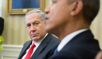 Benjamin Netanyahu, Israel's prime minister, left, looks on as U.S. President Barack Obam aspeaks in the Oval Office of the White House, on March 3, 2014.